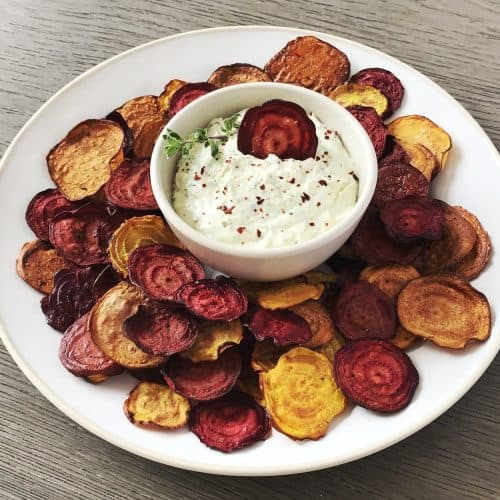 Beet Chips with Spicy Goat Cheese dip served on a white plate