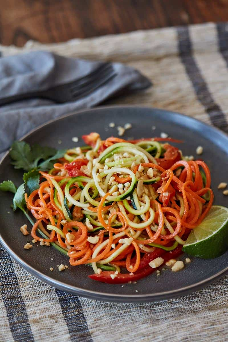 Thai Zoodles Salad served on gray plate on striped placemat