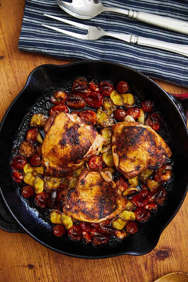 Easy Balsamic Chicken served in a skillet on a wooden surface