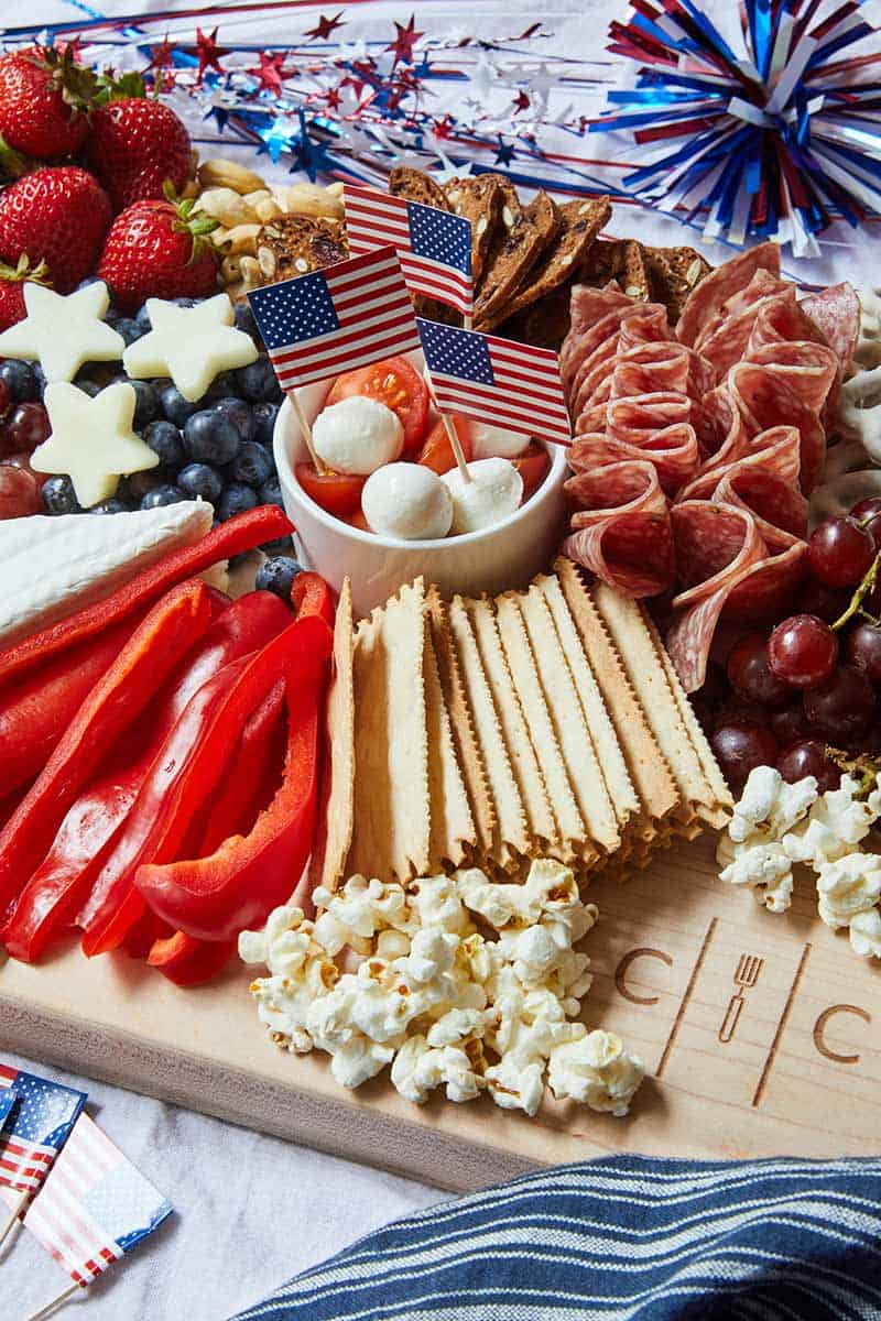 4th of July Themed Cheese Board next to 4th of july decorations
