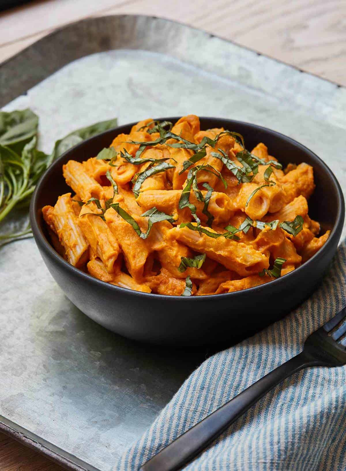 Butternut Squash Pasta served in black bowl on metal tray
