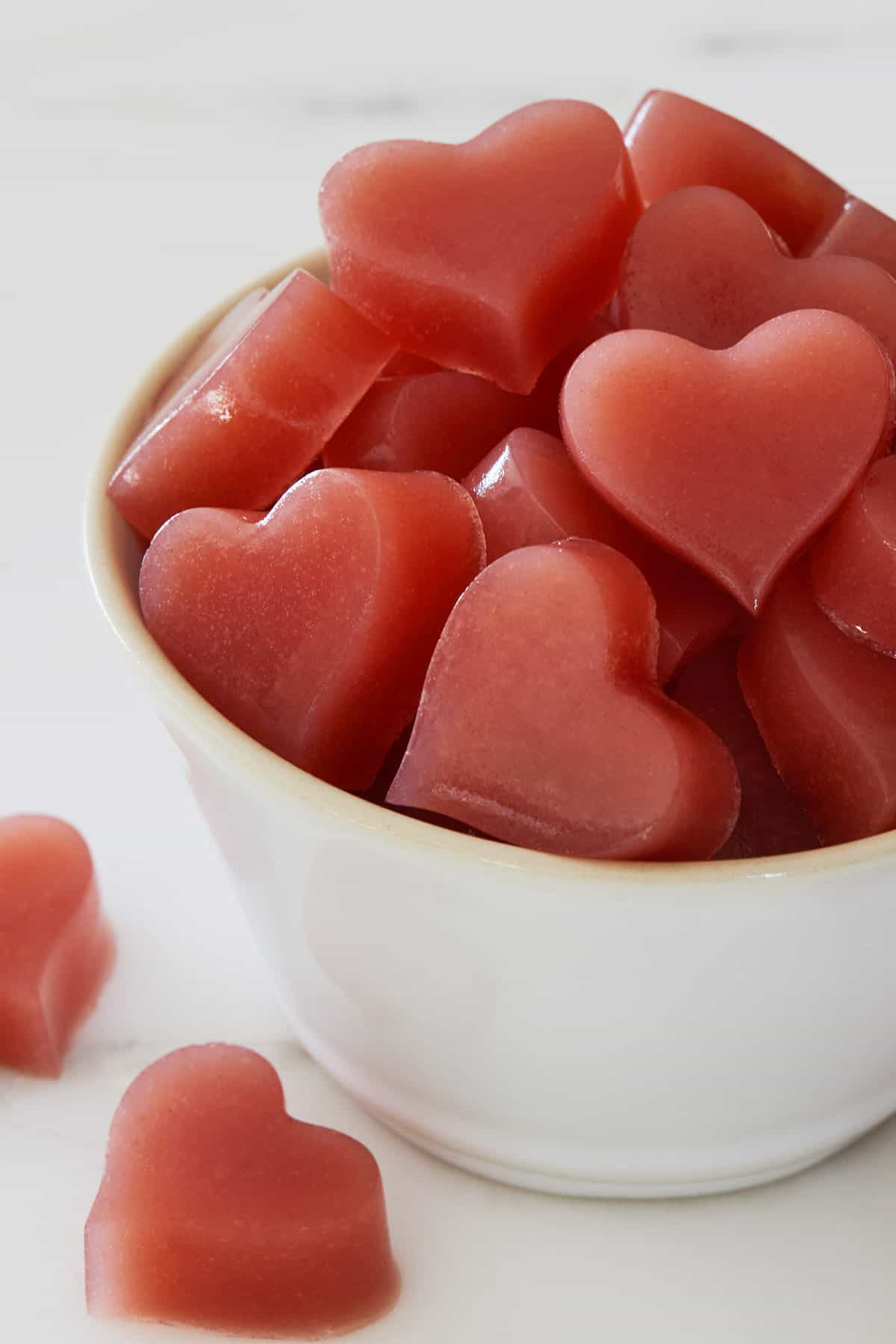 Apple Cider Vinegar Gummy Hearts stacked in a white bowl