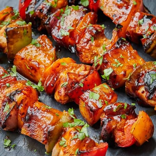 Hawaiian Chicken Skewers on a black countertop