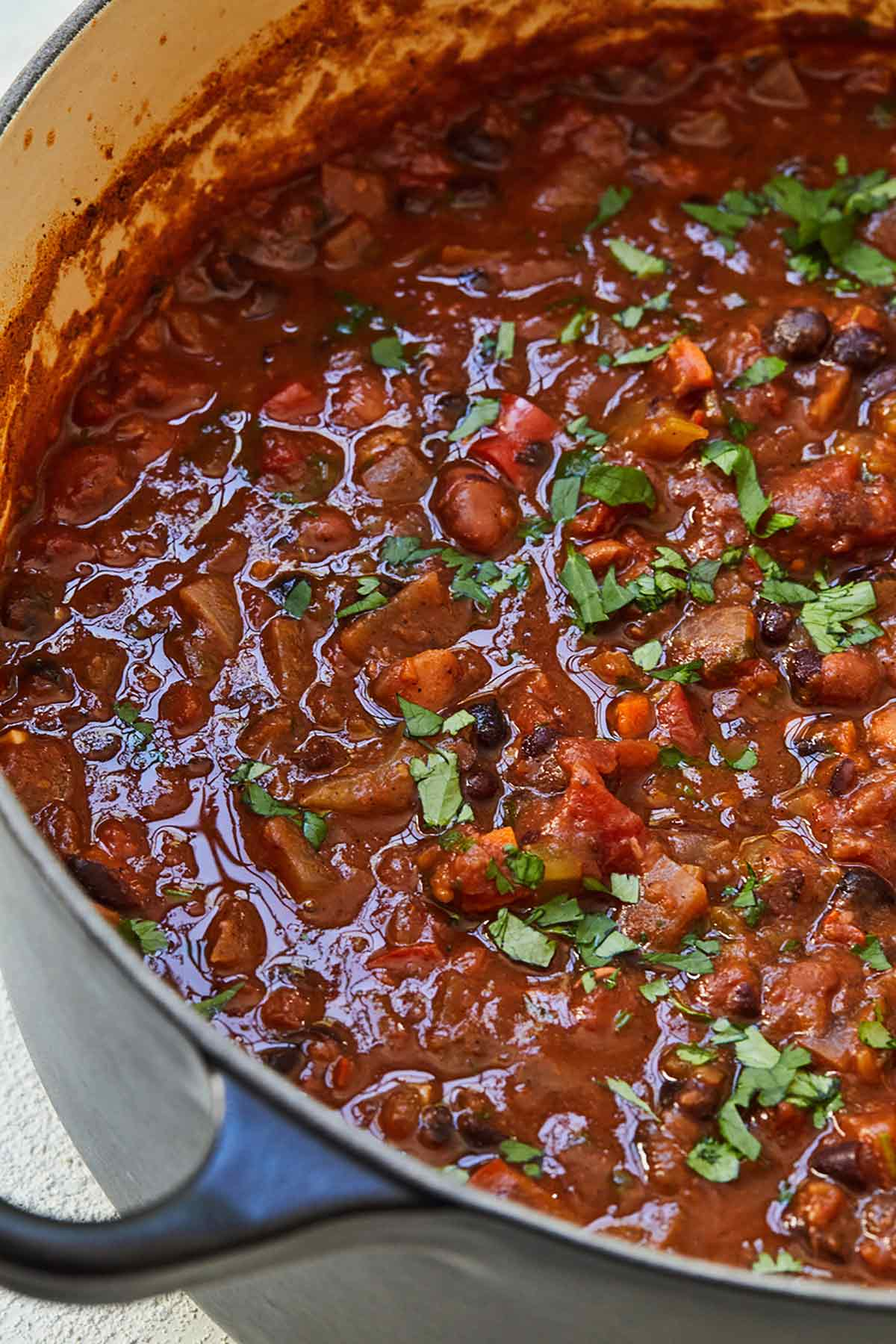 Close up of a pot of meatless chili. featuring black beans.