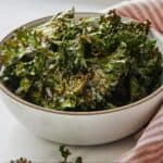 Pinterest graphic of a bowl of oven roasted kale chips.