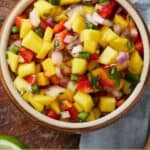 Pinterest graphic of an overhead view of a bowl of mango salsa.