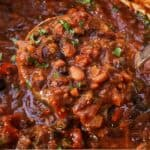 Pinterest graphic of a ladle full of vegetarian chili.