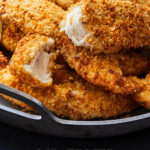 Pinterest graphic of a chicken tender ripped in half.