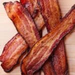 Pinterest graphic of a stack of four bacon strips.
