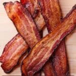 Pinterest graphic of strips of bacon stacked on top of each other.