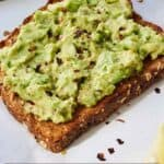 Pinterest graphic of a slice of avocado toast with red chili flakes.
