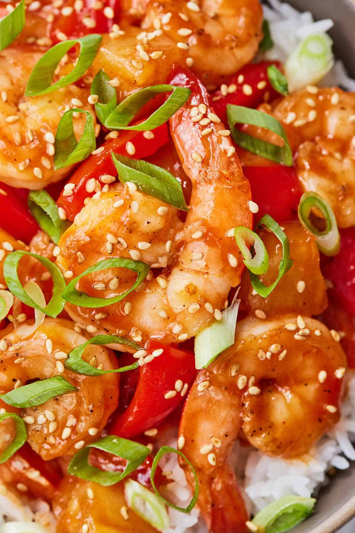 Close up of a bowl of sweet and sour shrimp.