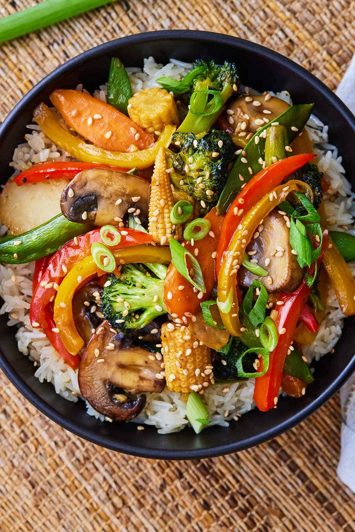 Overhead view of a bowl of stir fry with rice.