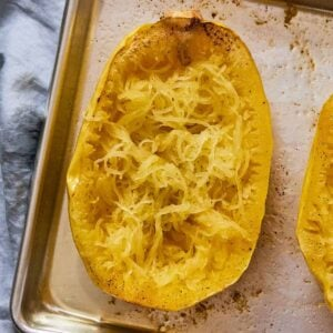 Close up of half a spaghetti squash with the noodles formed in the inside.