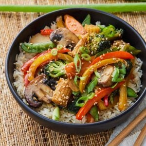 Bowl of vegetable stir fry over rice.