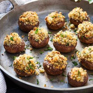 A platter of twelve vegetarian stuffed mushrooms.