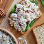 Pinterest graphic of chicken salad on top of lettuce on a slice of bread.