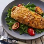 Pinterest graphic of a plate of salad and chicken paillard.