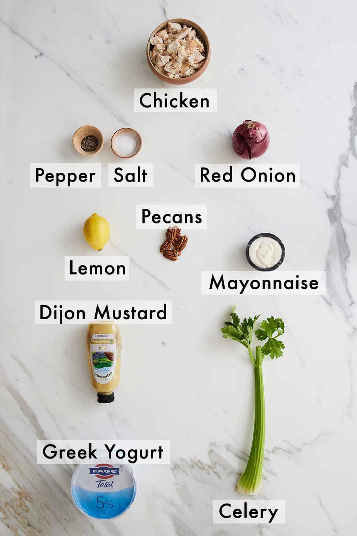Ingredients needed to make chicken salad.