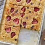 Pinterest graphic of sheet pan pancakes with a slice removed from the pan.