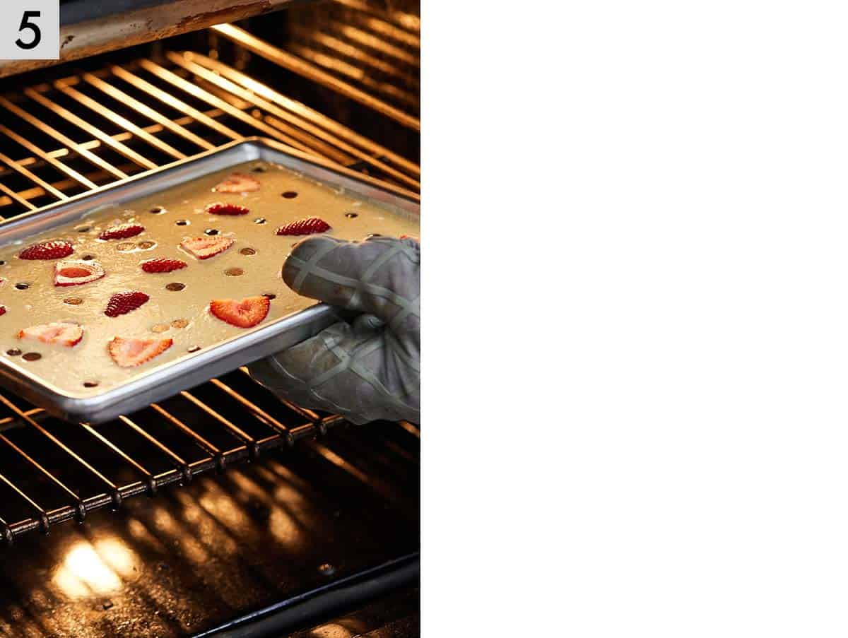 Photo showing sheet pan being placed into the oven.