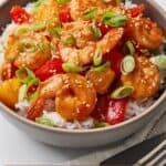 Pinterest graphic of a bowl of sweet and sour shrimp garnished with green onions.