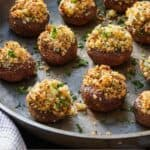 Pinterest graphic of a large plate of vegetarian stuffed mushrooms.