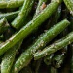 Pinterest graphic of a close up image of air fryer green beans.