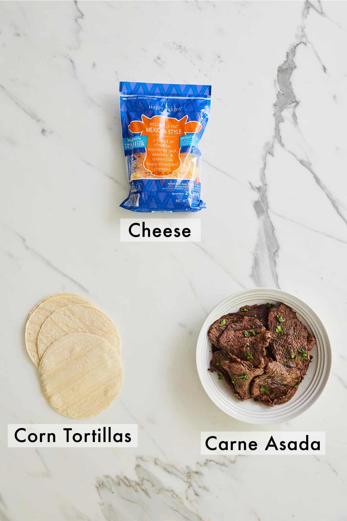 Ingredients needed to make carne asada tacos.