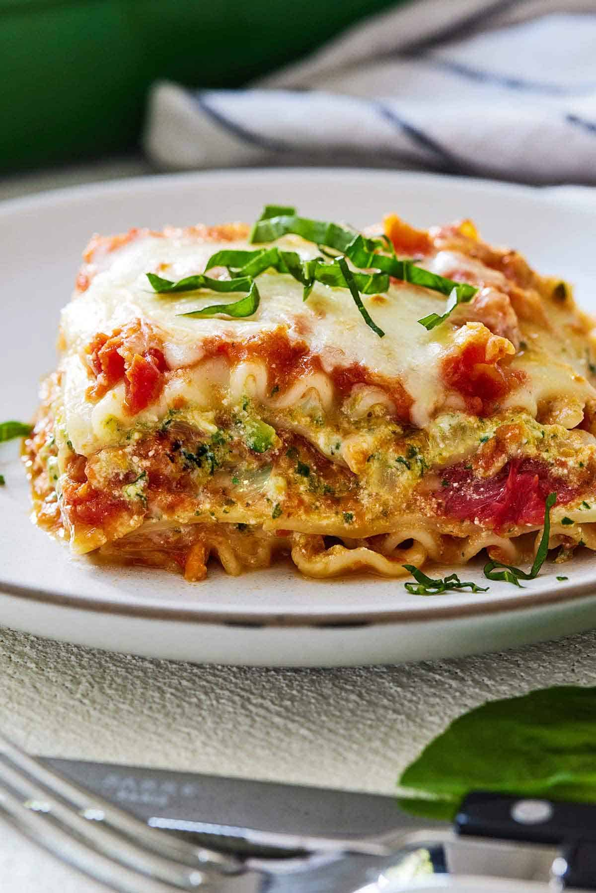 A profile shot of a serving of vegetarian lasagna, showing the layers.