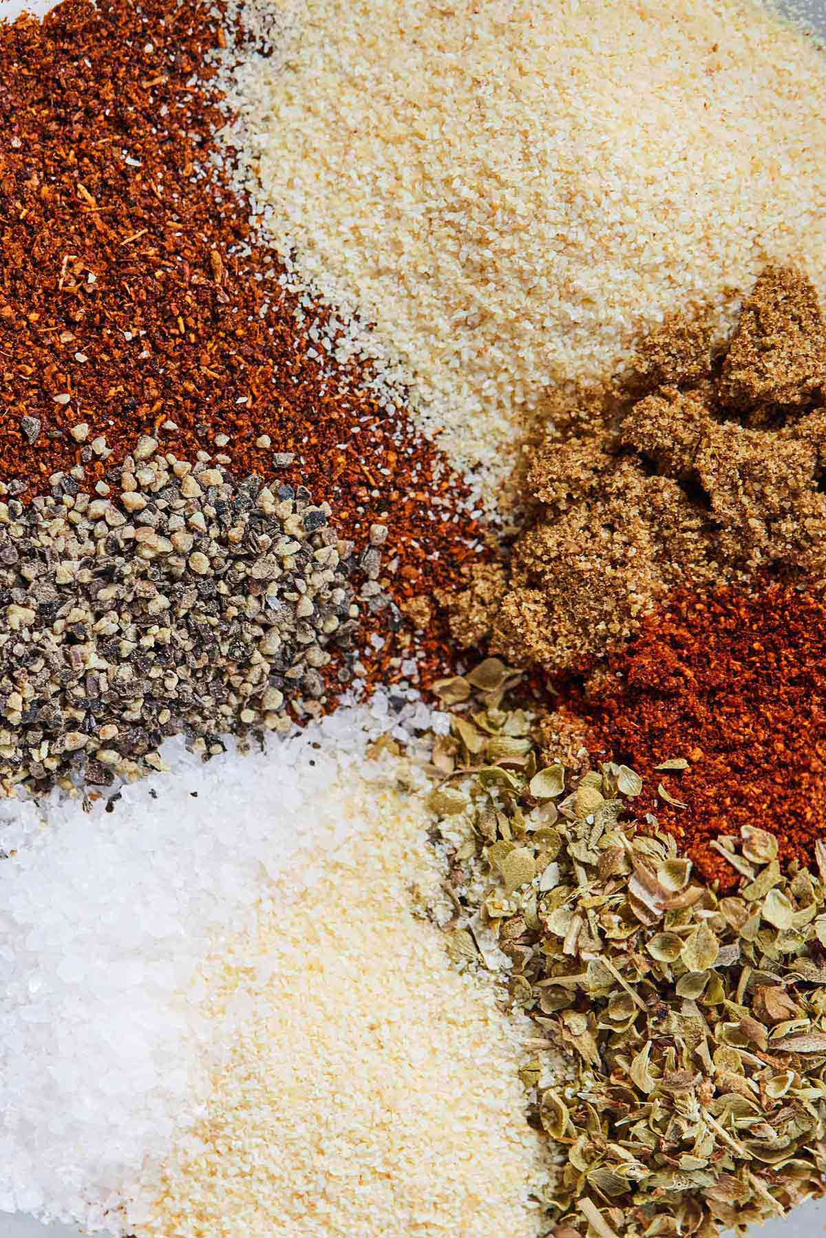 Overhead view of taco seasoning divided by the spices.