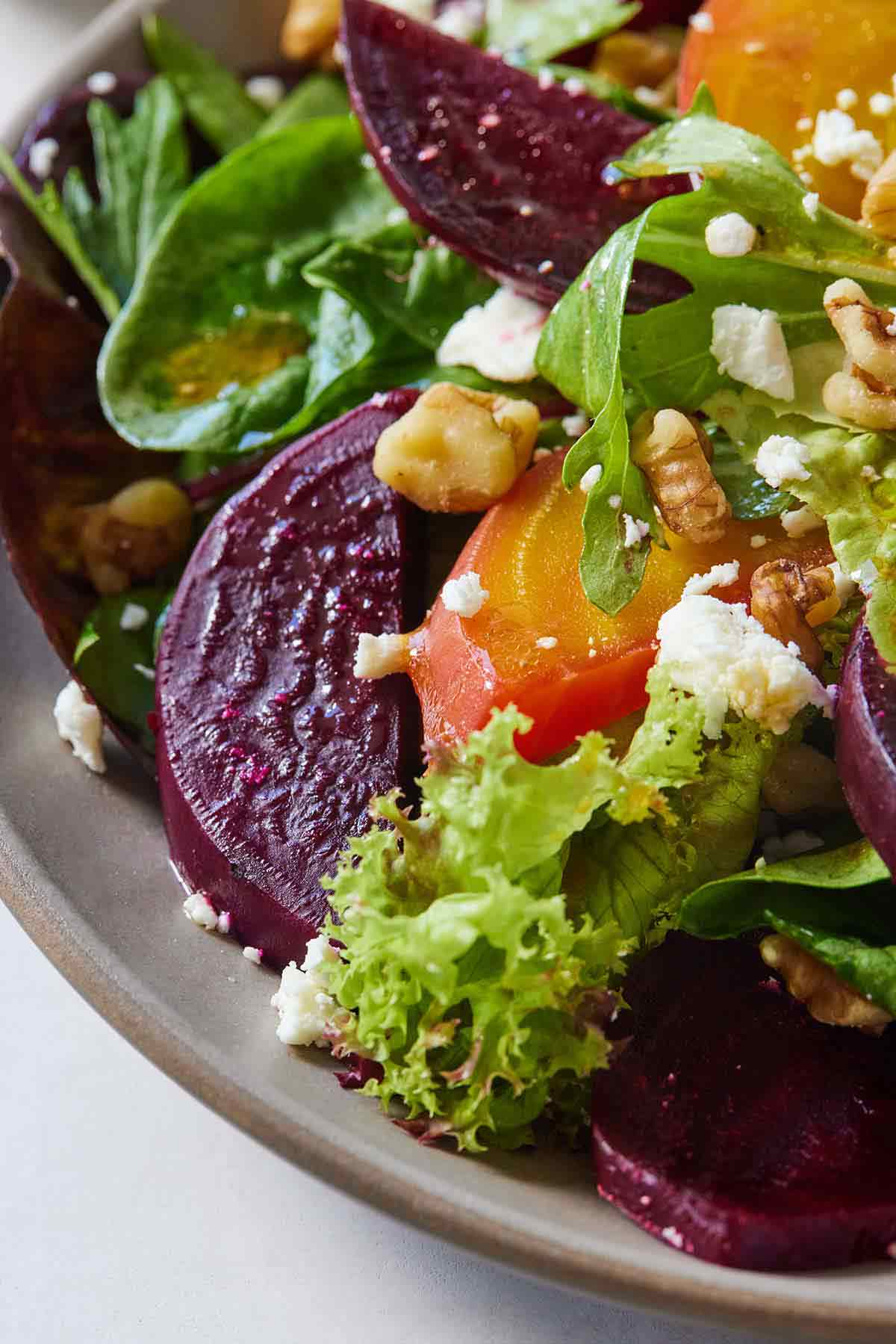 Close up image of a plate of beet salad.