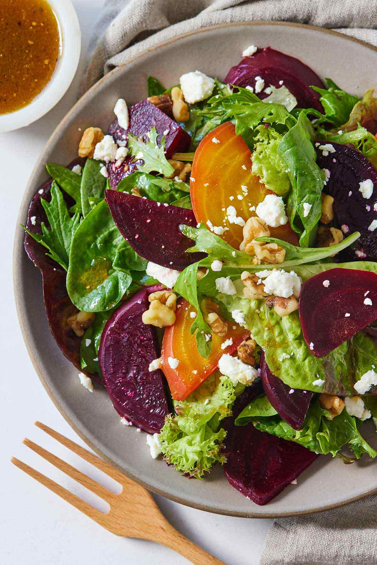 Overhead view of a plate of beet salad, off centered.