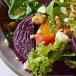 Pinterest graphic of a close up image of a beet salad featuring two different colored beets.