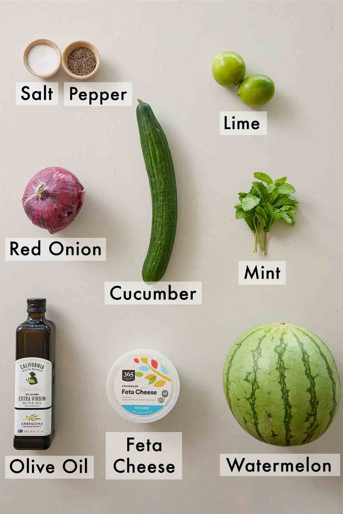 Ingredients needed to make a watermelon salad.